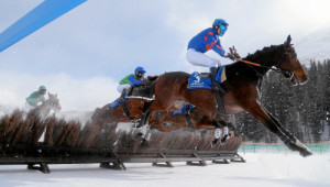 ST. MORITZ, 8FEB15 - Pathonn Sacha (R) mit Sylvain Dehez springt ueber die Huerde im 'Preis von Arosa', einem Huerdenrennen ueber 2300 m, anlaesslich des 1. Renntages von White Turf in St. Moritz am 8. Februar 2015.    Impression of the White Turf St. Moritz, the famous international horse races take place on the frozen lake of St. Moritz, Switzerland, February 8, 2015.     swiss-image.ch/Photo Andy Mettler