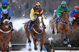 ST. MORITZ, 15FEB15 - (VLNR) Egisto mit Raphael Lingg, False Economy mit Silvia Casanova und Val de Roi mit Julien Lemee waehrend dem GP des Kantons Graubuenden dem 'World Snow Hurdle Championship Final', einem Huerdenrennen ueber 2700 m, anlaesslich des 2. Renntages von White Turf in St. Moritz am 15. Februar 2015.  Impression of the White Turf St. Moritz, the famous international horse races take place on the frozen lake of St. Moritz, Switzerland, February 15, 2015.   swiss-image.ch/Photo Andy Mettler