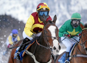 ST. MORITZ, 15FEB15 - False Economy mit Silvia Casanova im 'World Snow Hurdle Championship Final', einem Huerdenrennen ueber 2700 m, anlaesslich des 2. Renntages von White Turf in St. Moritz am 15. Februar 2015.    Impression of the White Turf St. Moritz, the famous international horse races take place on the frozen lake of St. Moritz, Switzerland, February 15, 2015.     swiss-image.ch/Photo Andy Mettler
