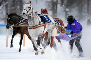 ST. MORITZ, 8FEB15 - Sano di Pietro mit Alfredo Lupo Wolf waehrend dem 'Credit Suisse - GP von Celerina', einem Skikjoering Rennen ueber 2700 m, anlaesslich des 1. Renntages von White Turf in St. Moritz am 8. Februar 2015.  Impression of the White Turf St. Moritz, the famous international horse races take place on the frozen lake of St. Moritz, Switzerland, February 8, 2015.  swiss-image.ch/Photo Andy Mettler