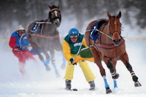 ST. MORITZ, 8FEB15 - Dreamspeed mit Franco Moro auf dem Weg zum Sieg im 'Credit Suisse - GP von Celerina', einem Skikjoering Rennen ueber 2700 m, anlaesslich des 1. Renntages von White Turf in St. Moritz am 8. Februar 2015.  Impression of the White Turf St. Moritz, the famous international horse races take place on the frozen lake of St. Moritz, Switzerland, February 8, 2015.  swiss-image.ch/Photo Andy Mettler