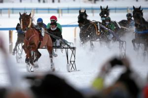 ST. MORITZ, 22FEB15 - Terry Gahn (M) mit Caroline Huguelet gewinnt ueberlegen den 'Grand Prix BMW', einem Trabrennen ueber 1700 m, anlaesslich des 3. Renntages von White Turf in St. Moritz am 22. Februar 2015.  Impression of the White Turf St. Moritz, the famous international horse races take place on the frozen lake of St. Moritz, Switzerland, February 22, 2015.  swiss-image.ch/Photo Andy Mettler