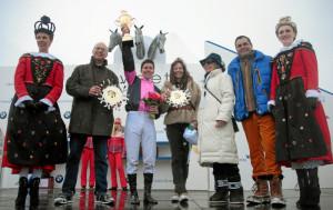 ST. MORITZ, 14FEB16 - Raphael Lingg (3. v. L) wird zum Sieger gekuert des 'H.H. Sheikh Zayed Bin Sultan Al Nahyan Listed Cup', einem Flachrennen am zweiten Renntag des White Turf in St. Moritz am 14. Februar 2016.  Impression of the White Turf St. Moritz, the famous international horse races on the frozen lake of St. Moritz, Switzerland, February 14, 2016.   swiss-image.ch/Photo Andy Mettler